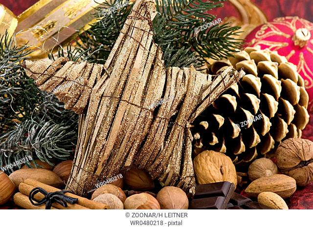 Christmas decoration with a star and pine cone as closeup