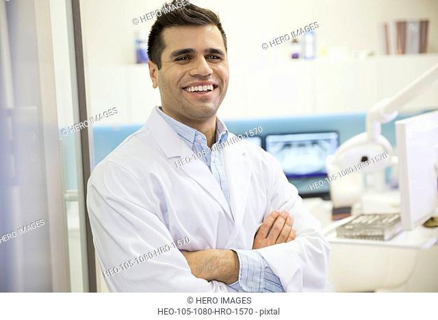 Dentist laughing in doorway of office