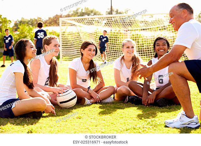 Coach Giving Team Talk To Female High School Soccer Team
