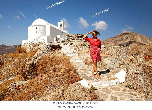 Woman at the stairs of the Agios Constantinos church in Hora, Serifos, Cyclades Islands, Greek Islands, Greece, Europe