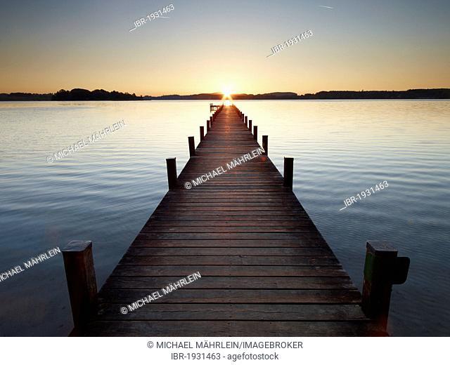 Pier in Lake Woerthsee at sunrise, Bavaria, Germany, Europe