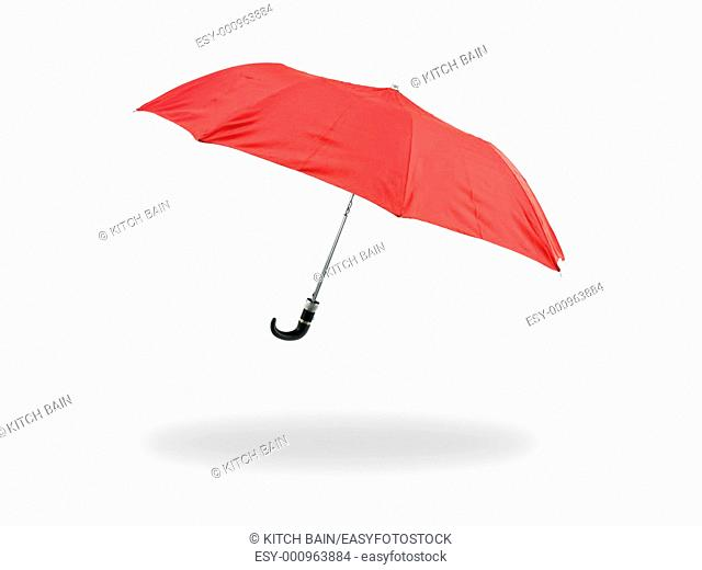 A red umbrella isolated against a white background