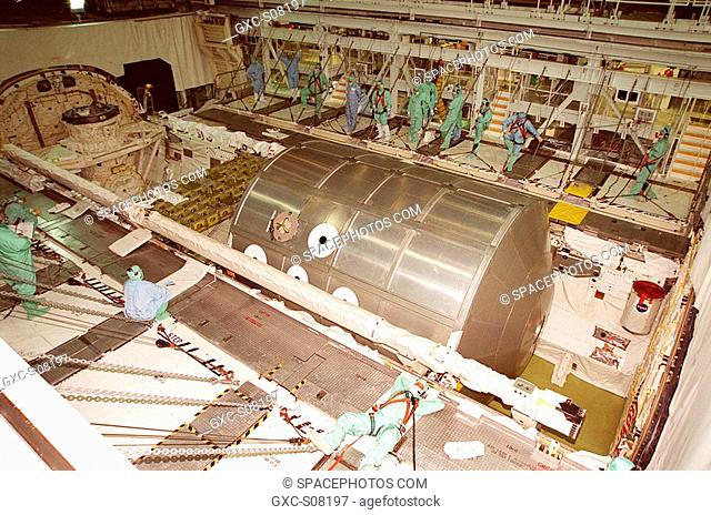 03/27/2001 -- In the Orbiter Processing Facility bay 2, Discovery's payload bay doors are open to reveal the Multi-Purpose Logistics Module Leonardo