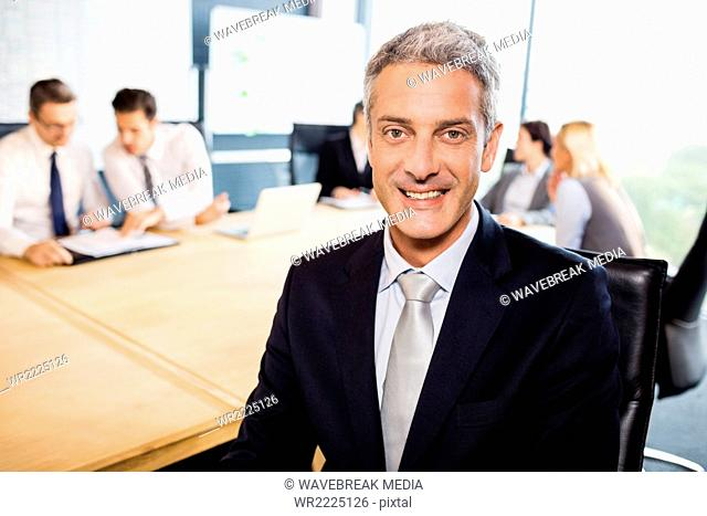 Businessman smiling at the camera during meeting
