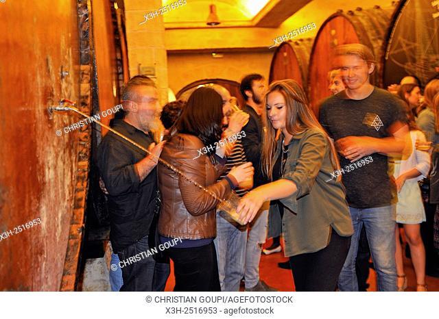 â. œtxotx tasteâ. . drinking cider straight from de huge wood barrel, Petritegi Cider House, village of Astigarraga, province of Gipuzkoa, Basque Country, Spain