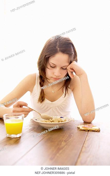 Teenager eating breakfast