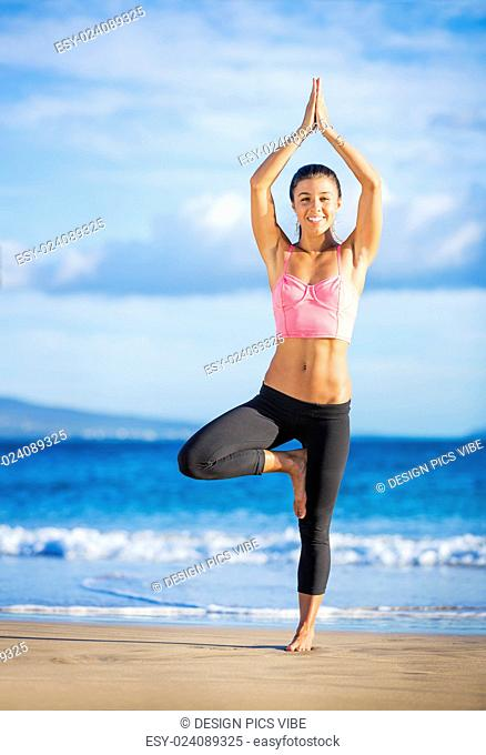 Young woman practicing yoga on the beach at sunset, Wellness Concept Healthy Lifestyle