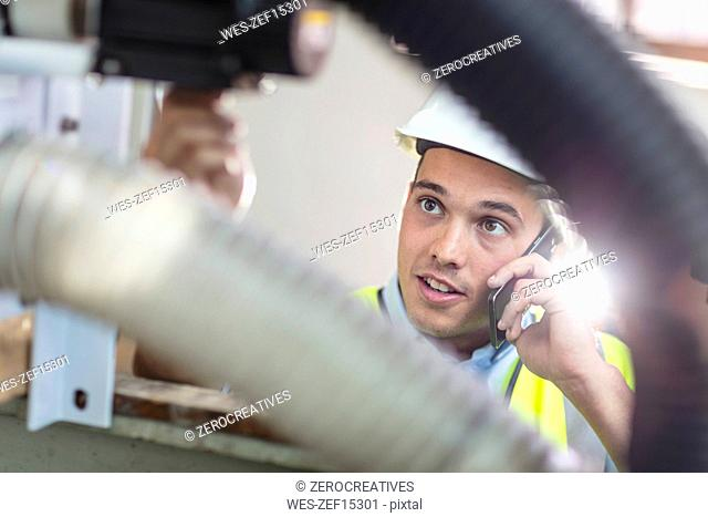 Technician at work talking on cell phone