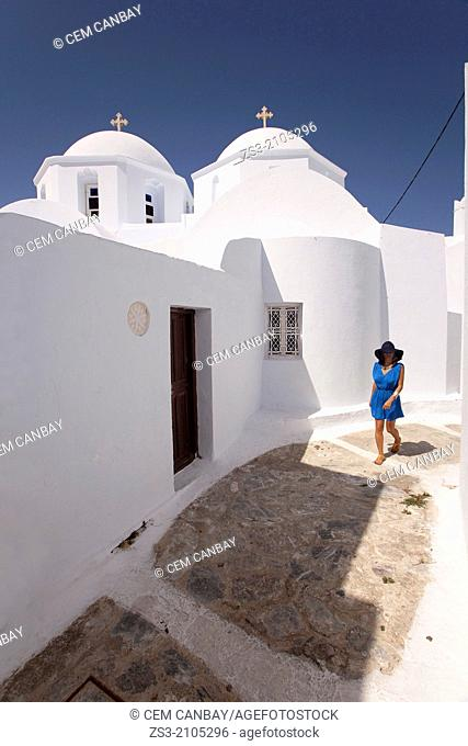 Woman walking near a church, Chora, Amorgos, Cyclades Islands, Greek Islands, Greece, Europe