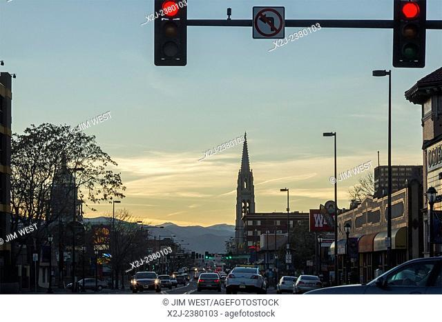 Denver, Colorado - Colfax Avenue, the main east-west street in Denver, looking west towards the Rocky Mountains. The church is the Cathedral Basilica of the...