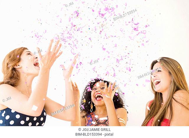 Women celebrating with confetti