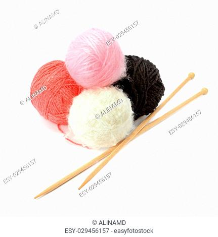 skeins of yarn and knitting needles isolated on a white background