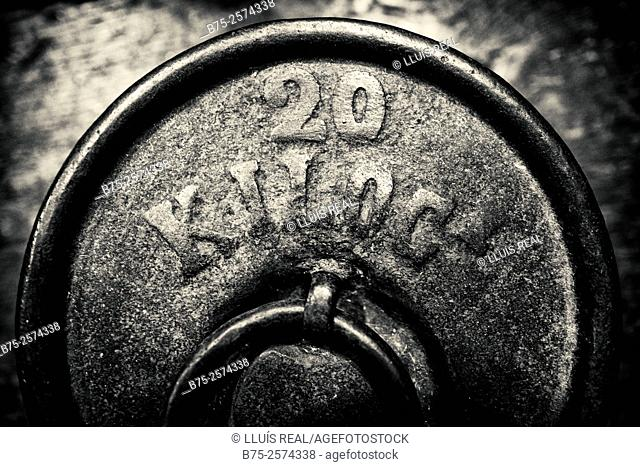 Close up of an old weighing 20 kilograms