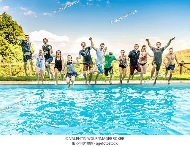Group of teenagers, Teens jumping in pool, Lazio, Italy