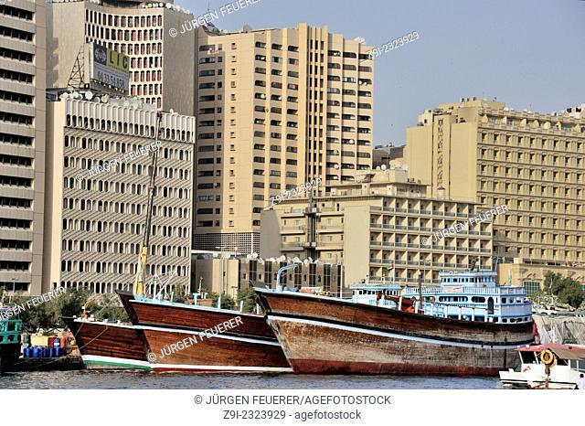 High-rise buildings next to the ships, Dubai Creek, Dubai, United Arab Emirates