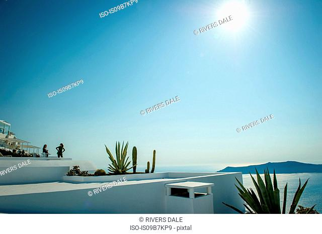 View across rooftops of buildings, Oía, Santorini, Kikladhes, Greece
