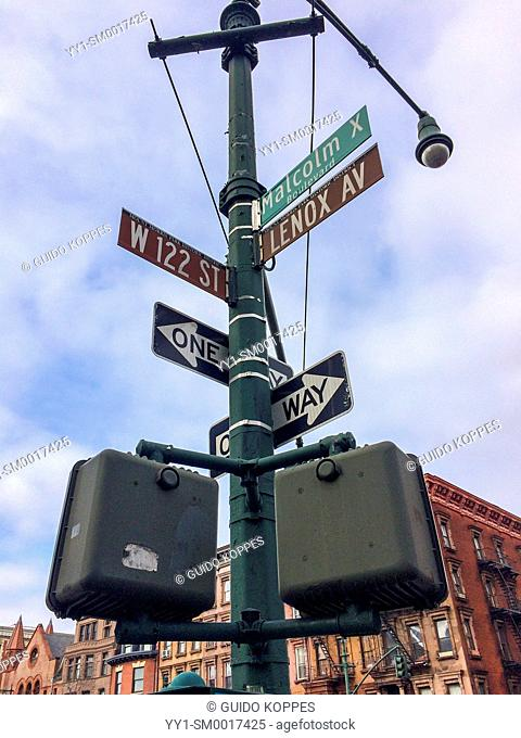 Harlem, New York City, USA. Streetsign and security camera on the corner of 122nd Street and Lennox Ave / Malcolm X Blvd