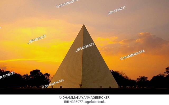 Now Chand Khonnokyoong Memorial Hall at the at Phra Dhammakaya temple at sunset, hexagonal pyramid, Khun Yai Vihara, Khlong Luang District, Pathum Thani