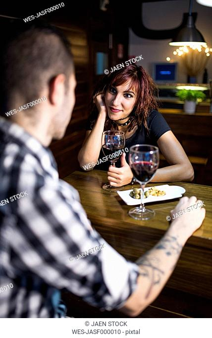 Young couple in modern restaurant having a rendezvous