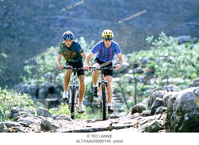 Two men riding mountain bikes
