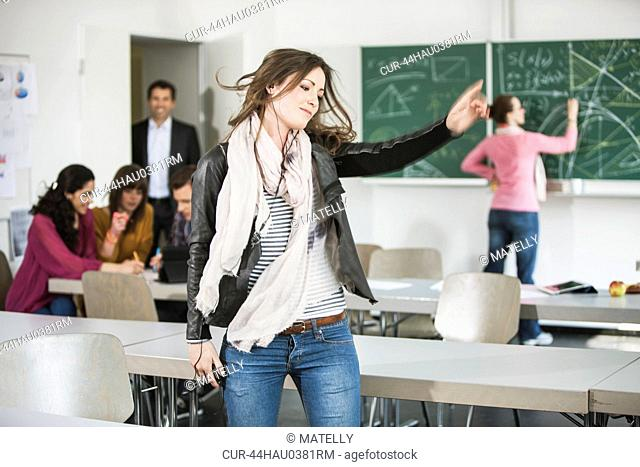 Student dancing to mp3 player in class