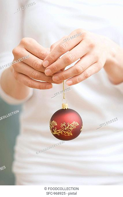 Woman holding Christmas bauble