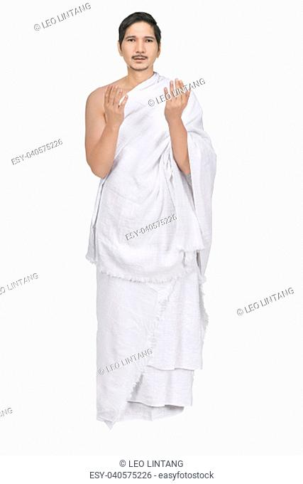 Handsome asian muslim with ihram cloth isolated over white background