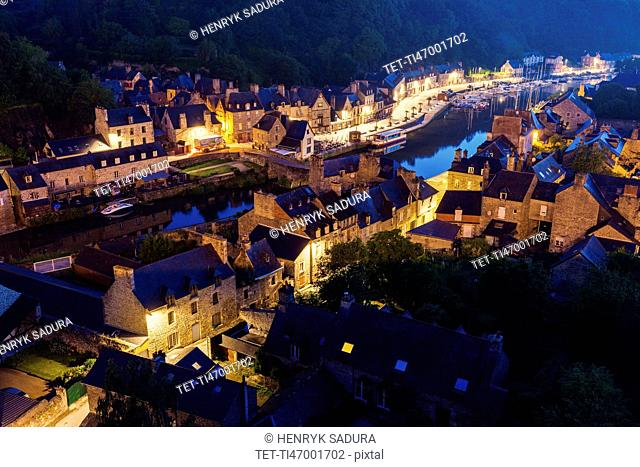 France, Brittany, Dinan, Cityscape with river at dusk