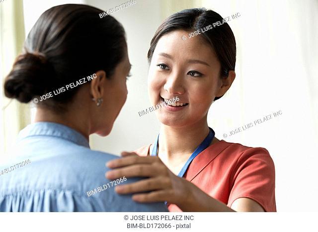 Nurse talking to patient in office