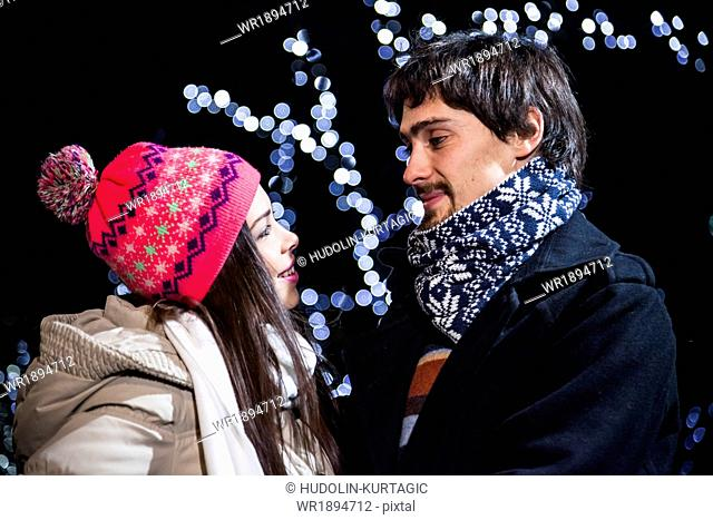 Young couple falling in love at Christmas Market