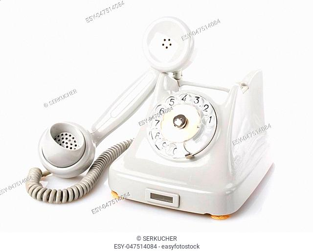 Retro rotary old phone on white background