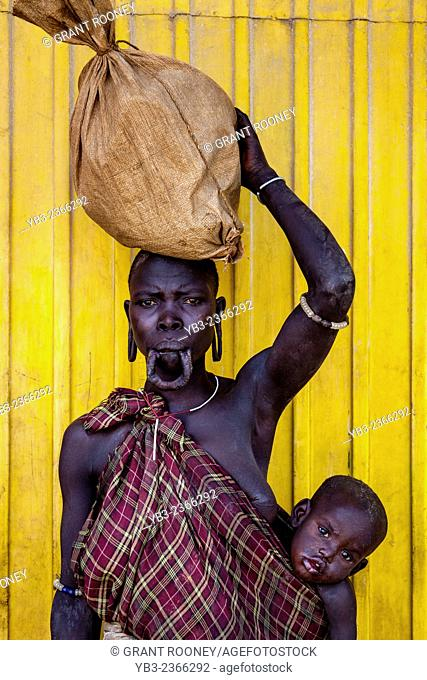 Portrait Of A Woman and Baby From The Mursi Tribe, Jinka Town, Omo Valley, Ethiopia
