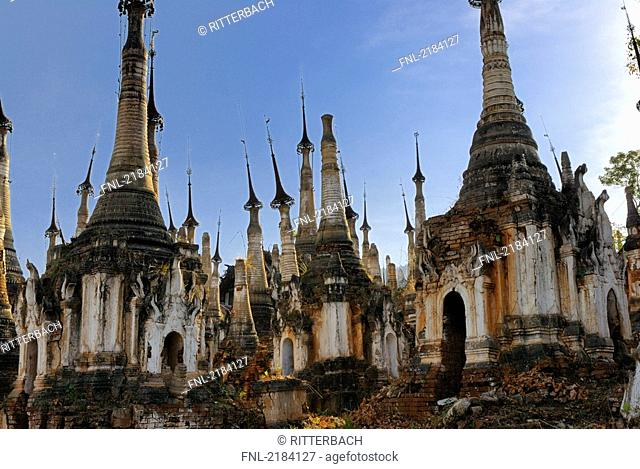 Old ruins of pagodas against blue sky, Shwe Intaing Pagoda, Myanmar