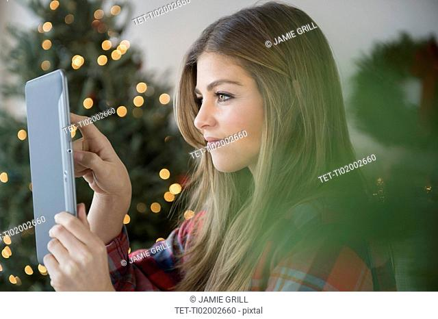 Woman taking photo with digital tablet