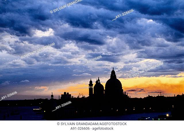 Stormy sky. La Salute church. The Grand Canal at dusk. Venice. Italy