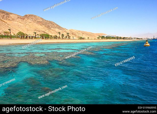 View on red mountains along beautiful shoreline of Red Sea in Eilat, Israel