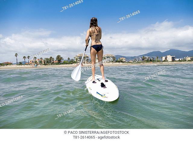 girls doing paddleboard, Peñiscola, Spain