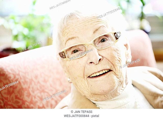 Portrait of senior woman with Alzheimer's disease