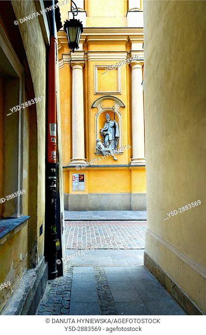 Architectural detail - symbols in arts - Saint Martin helps poor man, St. Martin's Church - Kosciol Sw. Marcina, located on ulica Piwna - Beer Street seen from...