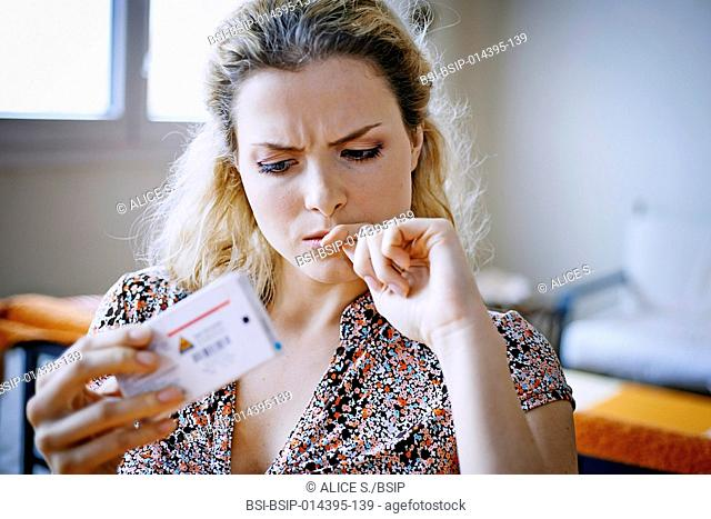 Woman holding box of medicines