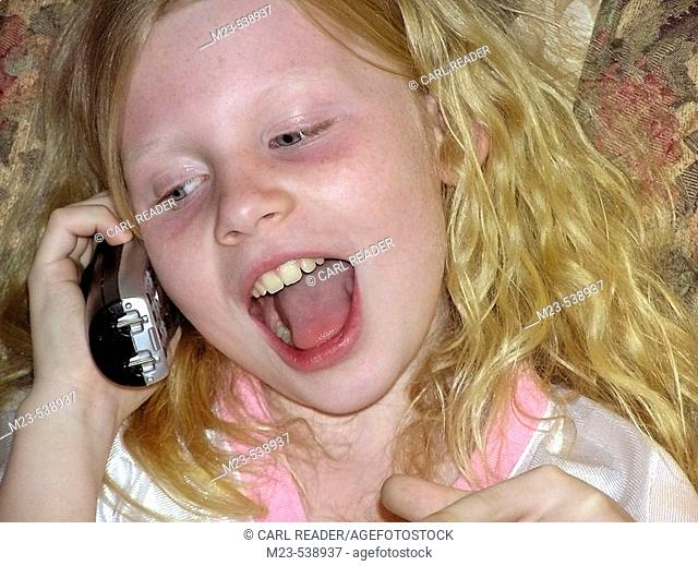 A little girls yaks on the phone