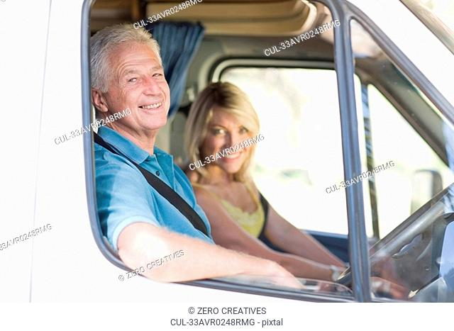 Older couple driving RV