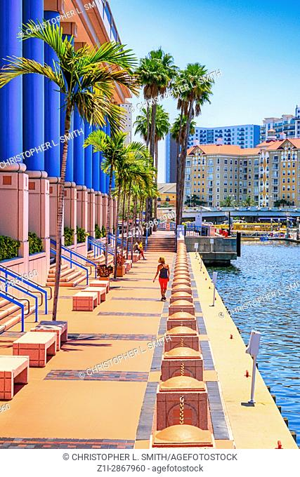 People outside the pink Tampa Convention Center building in Florida