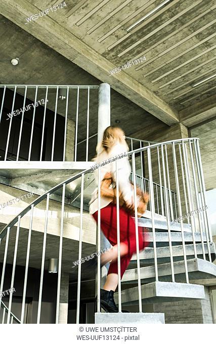 Businesswoman rushing upstairs