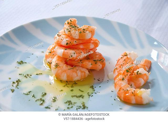Piled prawns with olive oil and parsley. Spain