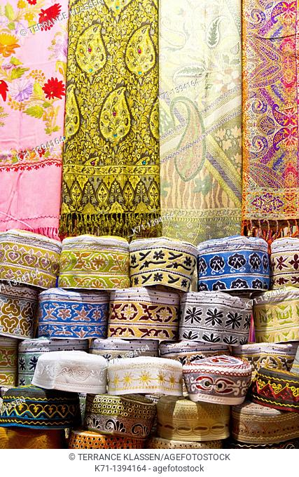 Closeup of textiles, scarves and hats for sale at the Muttrah souq market in Muscat, Oman