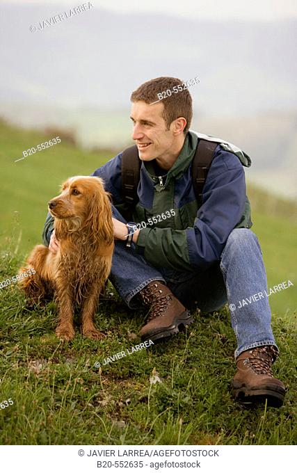 Hiker and Cocker Spaniel dog