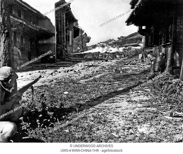 Tengchung, China: October 4, 1944.A Chinese flame thrower sends a searing stream towards a Japanese pillbox in the fight for Tengchung