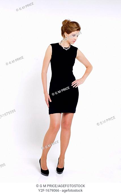 young woman in black dress in relaxed pose