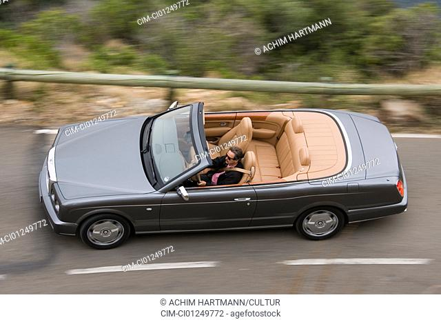 Bentley Azure, model year 2006-, anthracite, driving, diagonal from above, country road, open top